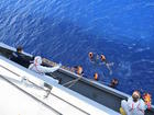 Italy says migrant ship overturned off Libya