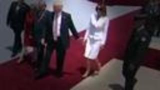 Did the first lady try to swat Trump's hand?
