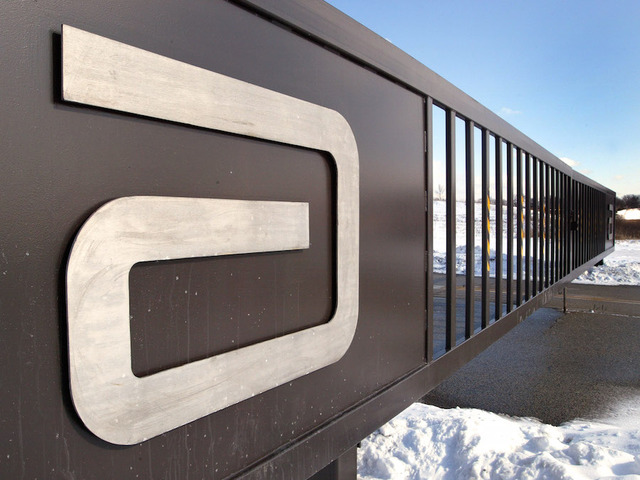 An Abbott Laboratories Logo Is Visible On A Security Gate Near Its Headquarters February 10 2004 In Park Illinois