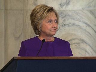 Clinton backs girl who knelt during Pledge