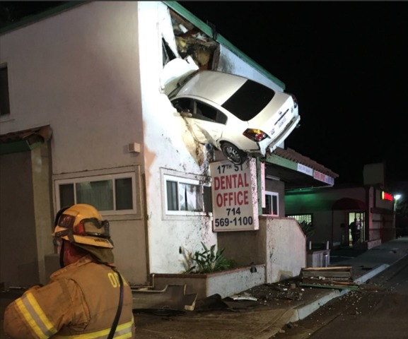Vehicle goes airborne, crashes into second floor of Santa Ana dentist's office