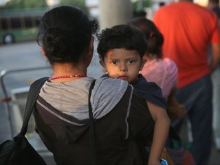Youngest migrants held in 'tender age' shelters