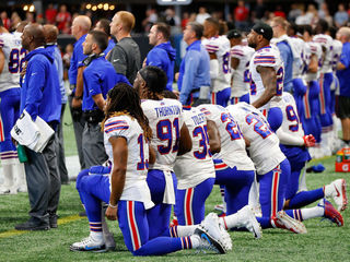 NFL owners approve policy for kneeling players