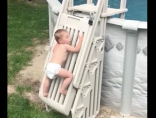 Video show toddler climbing a pool safety ladder